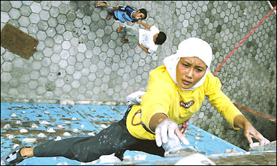 Wearing her hijab, or headscarf, champion speed climbing champion Etti Hendrawati practises for the Extreme Games in Asia