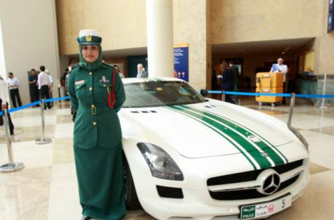 Hijabi Officer Badria Al Swuidi with her Mercedes police car